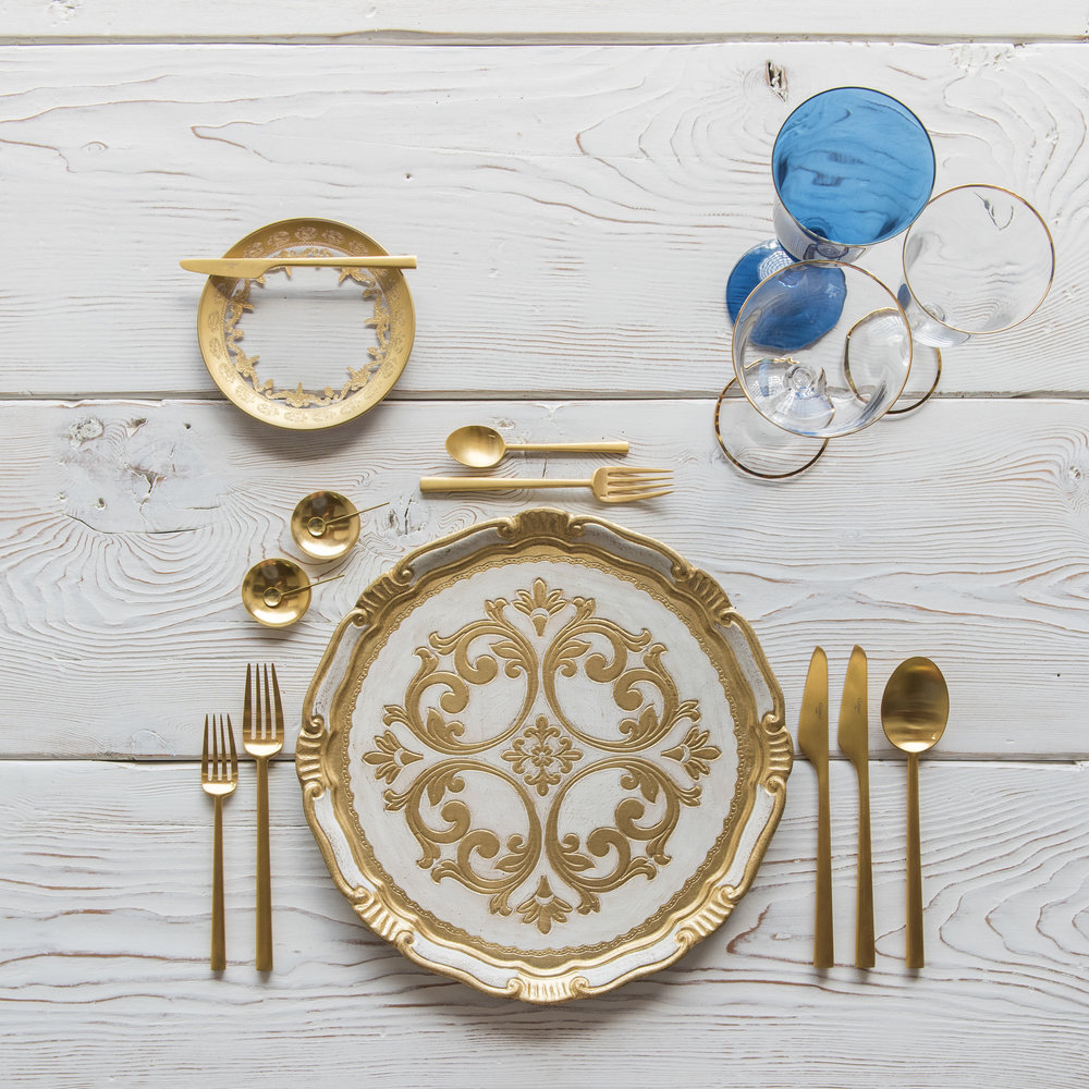 RENT: Florentine Chargers in White/Gold + Versailles Glass Dinnerware in 24k Gold + Rondo Flatware in Brushed 24k Gold + Chloe 24k Gold Rimmed Stemware + Chloe 24k Gold Rimmed Goblet in Sapphire + 14k Gold Salt Cellars + Tiny Gold Spoons   SHOP: Florentine Chargers in White/Gold + Rondo Flatware in Brushed 24k Gold + Chloe 24k Gold Rimmed Stemware + 14k Gold Salt Cellars + Tiny Gold Spoons
