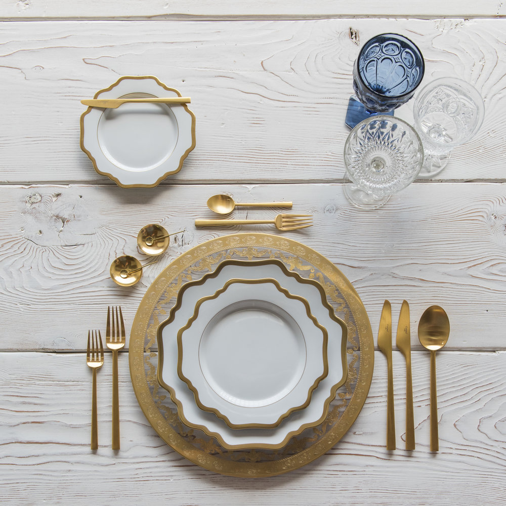 RENT: Versailles Glass Chargers in 24k Gold + Anna Weatherley Dinnerware in White/Gold + Rondo Flatware in Brushed 24k Gold + Dark Blue Vintage Goblets + Early American Pressed Glass Goblets + Vintage Champagne Coupes + 14k Gold Salt Cellars + Tiny Gold Spoons  SHOP: Anna Weatherley Dinnerware in White/Gold + Rondo Flatware in Brushed 24k Gold + 14k Gold Salt Cellars + Tiny Gold Spoons