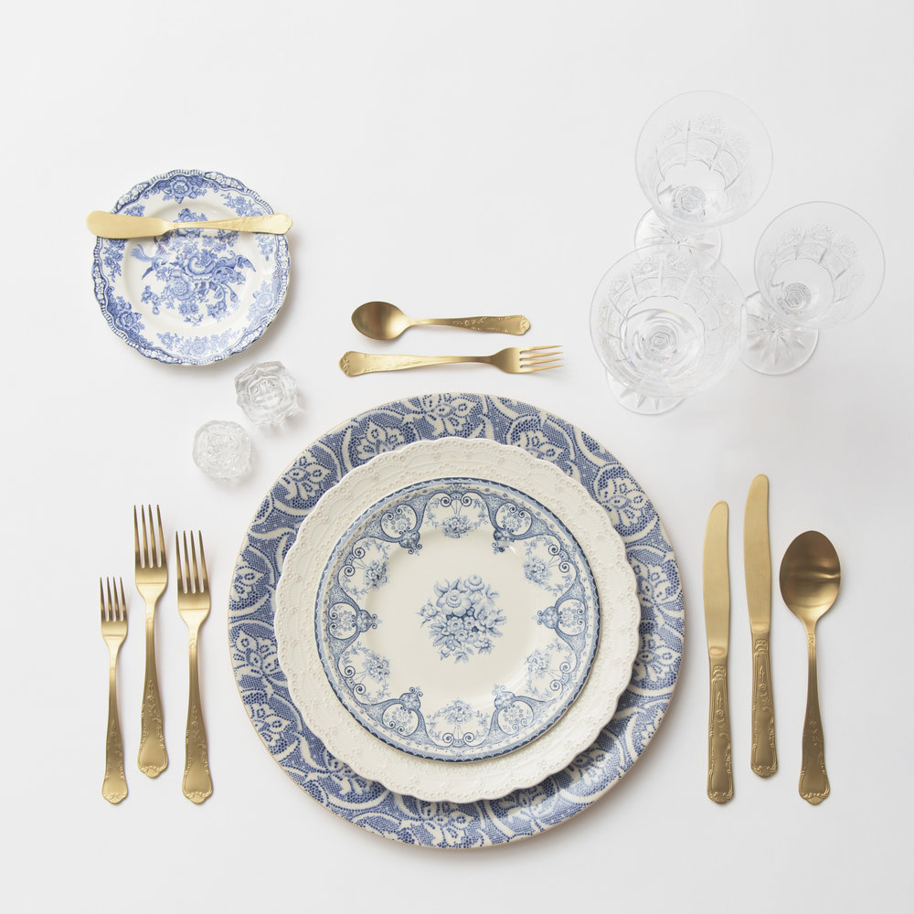 RENT: Blue Fleur de Lis Chargers + White Collection Vintage China + Blue Garden Collection Vintage China + Chateau Flatware in Matte Gold + Czech Crystal Stemware + Antique Crystal Salt Cellars