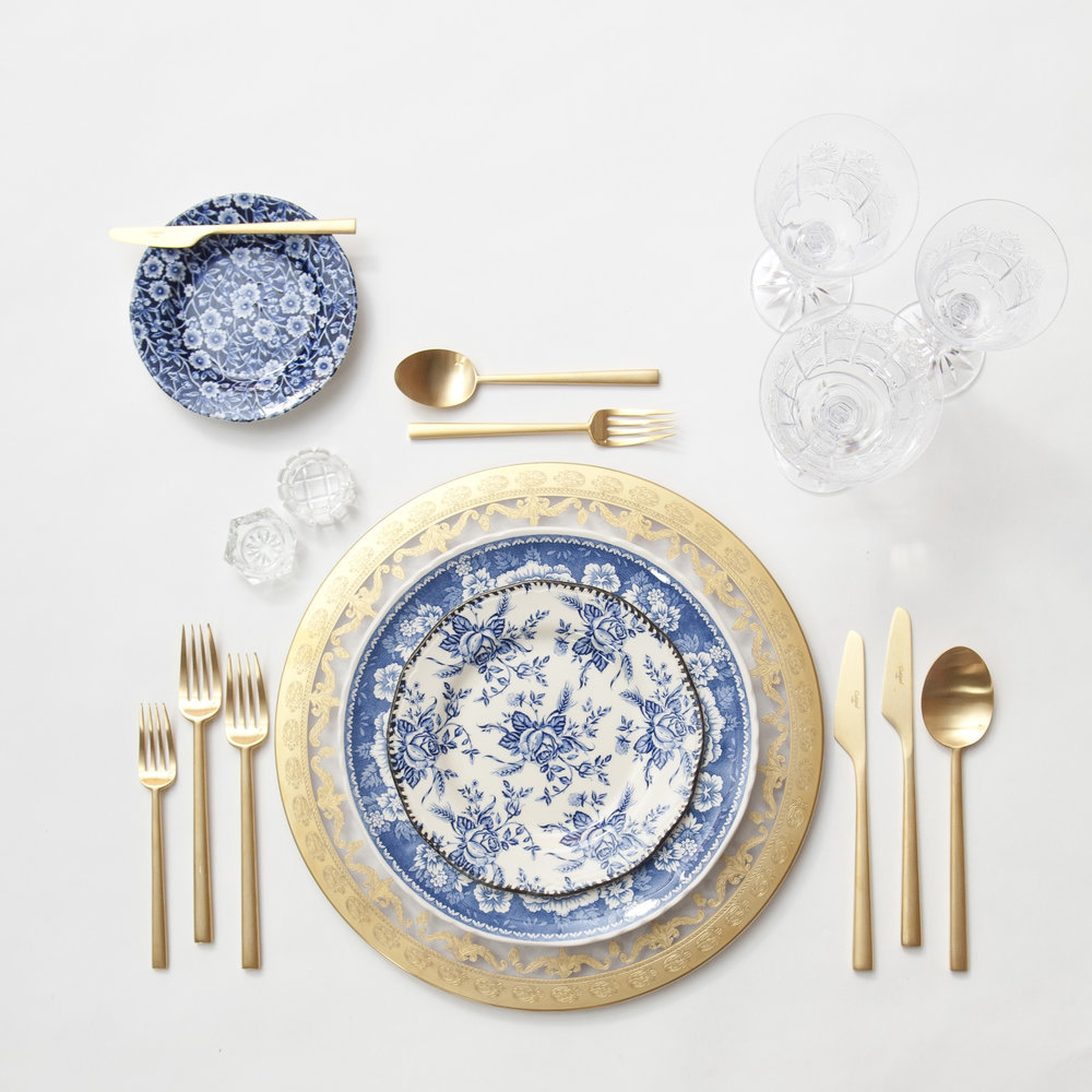 RENT: Versailles Glass Chargers in 24k Gold + Blue Garden Collection Vintage China + Rondo Flatware in Brushed 24k Gold + Czech Crystal Stemware + Antique Crystal Salt Cellars  SHOP: Rondo Flatware in Brushed 24k Gold