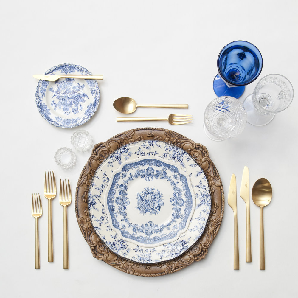 RENT: Verona Chargers in Walnut + Blue Garden Collection Vintage China + Rondo Flatware in Brushed 24k Gold + Dark Blue Vintage Goblets + Early American Pressed Glass Goblets + Vintage Champagne Coupes + Antique Crystal Salt Cellars   SHOP: Verona Chargers in Walnut + Rondo Flatware in Brushed 24k Gold