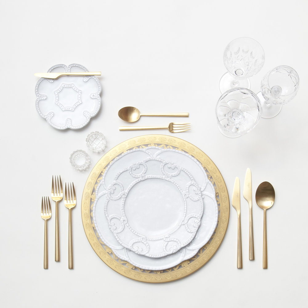 RENT: Versailles Glass Chargers in 24k Gold + Signature Collection Dinnerware + Rondo Flatware in Brushed 24k Gold + Vintage Cut Crystal Goblets + Vintage Champagne Coupes + Antique Crystal Salt Cellars  SHOP: Rondo Flatware in Brushed 24k Gold