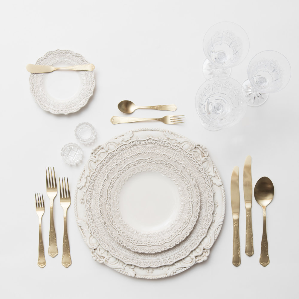 RENT: Verona Chargers in Antique White + Lace Dinnerware in White + Chateau Flatware in Matte Gold + Czech Crystal Stemware + Antique Crystal Salt Cellars  SHOP: Verona Chargers in Antique White