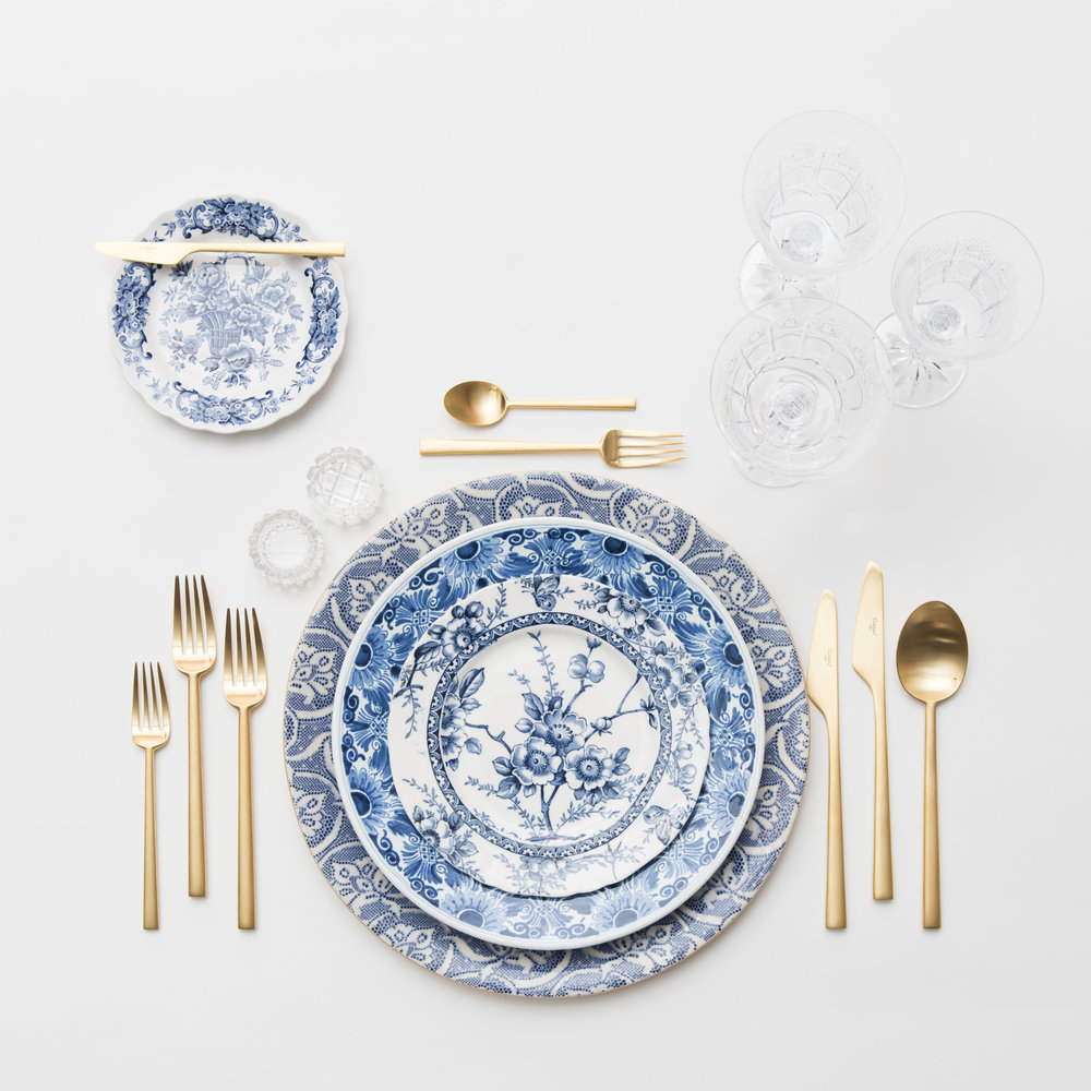 RENT: Blue Fleur de Lis Chargers + Blue Garden Collection Vintage China + Rondo Flatware in Brushed 24k Gold + Czech Crystal Stemware + Antique Crystal Salt Cellars  SHOP: Rondo Flatware in Brushed 24k Gold