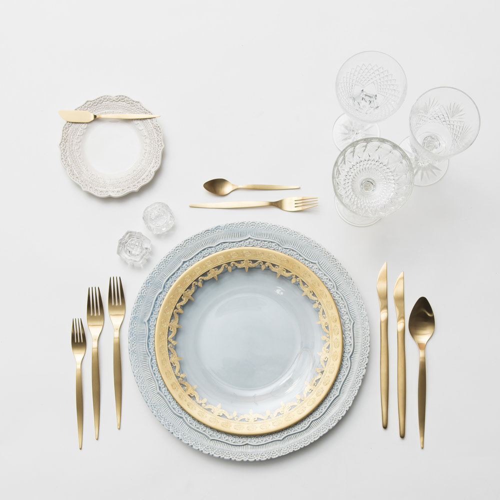 RENT: Lace Chargers in Dusty Blue + Lace Dinnerware in White + Versailles Glass Dinnerware in 24k Gold + Celeste Flatware in Matte Gold + Vintage Cut Crystal Goblets + Vintage Champagne Coupes + Antique Crystal Salt Cellars
