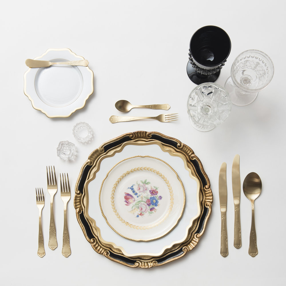 RENT: Florentine Chargers in Black/Gold + Anna Weatherley Dinnerware in White/Gold + White Botanicals Vintage China + Chateau Flatware in Matte Gold + Black Vintage Goblets + Early American Pressed Glass Goblets + Vintage Champagne Coupes + Antique Crystal Salt Cellars  SHOP: Florentine Chargers in Black/Gold + Anna Weatherley Dinnerware in White/Gold