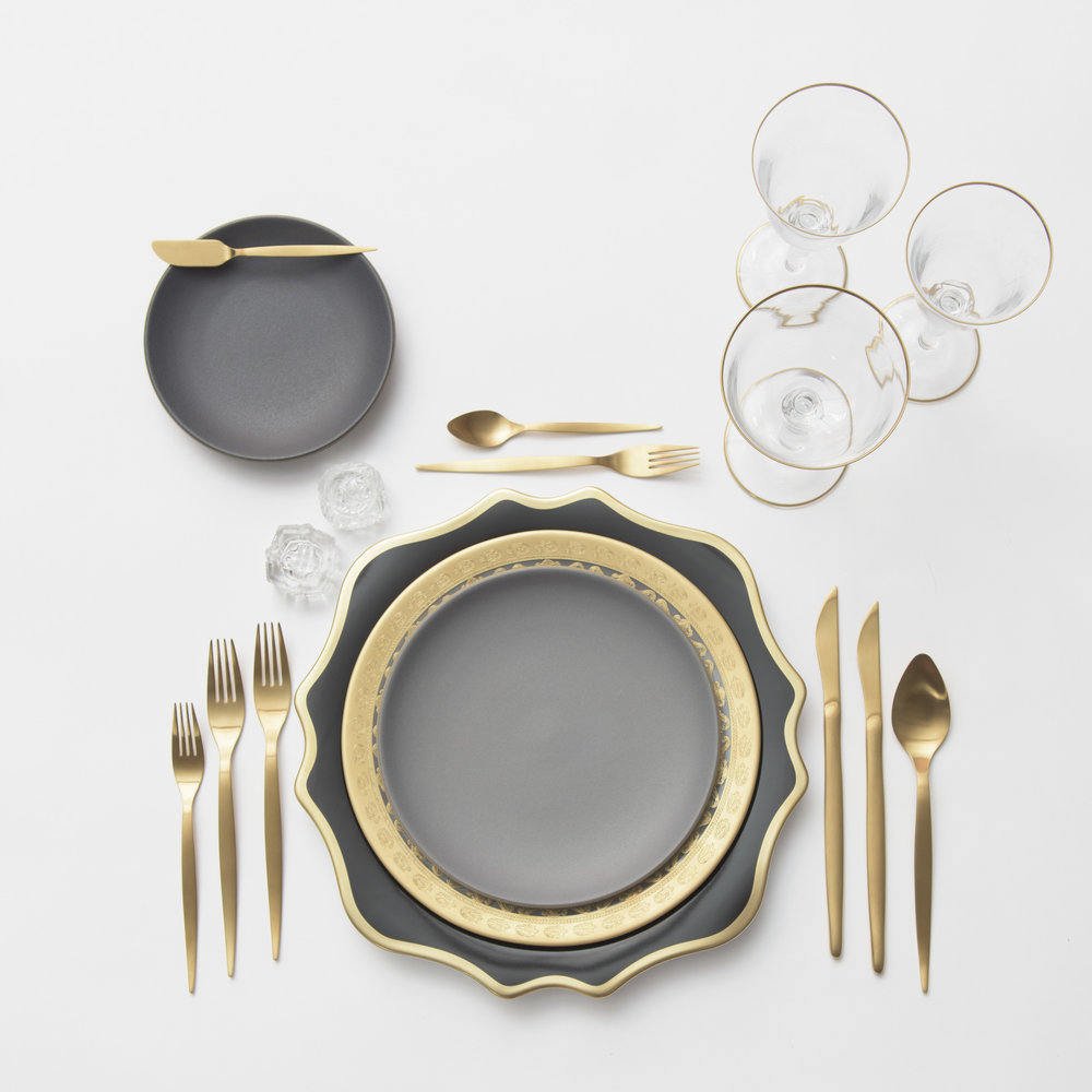RENT: Anna Weatherley Chargers in Black/Gold + Versailles Glass Dinnerware in 24k Gold + Heath Ceramics in Indigo/Slate + Celeste Flatware in Matte Gold + Chloe 24k Gold Rimmed Stemware + Antique Crystal Salt Cellars  SHOP: Chloe 24k Gold Rimmed Stemware