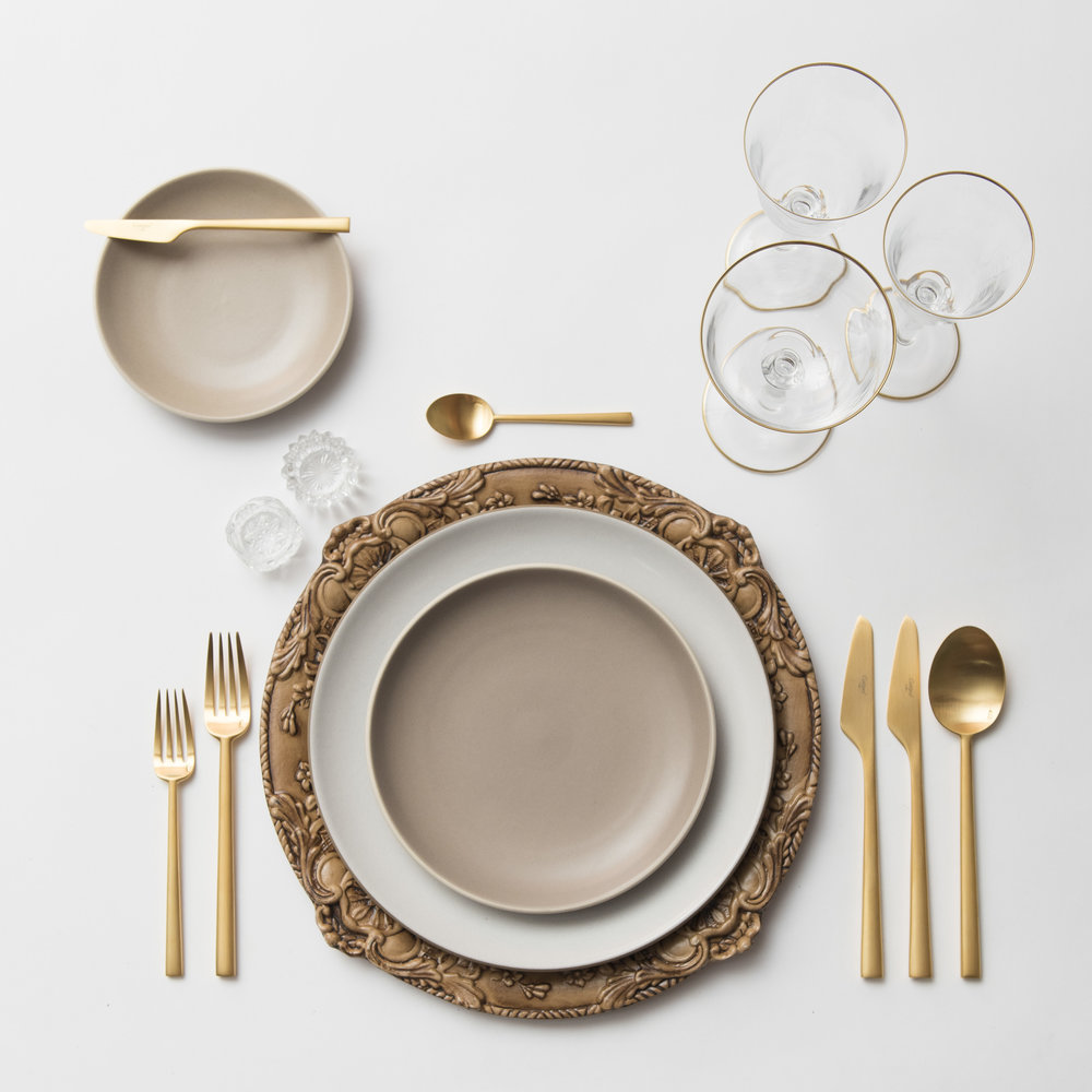 RENT: Verona Chargers in Walnut + Heath Ceramics in Opaque White/French Grey + Rondo Flatware in Brushed 24k Gold + Chloe 24k Gold Rimmed Stemware + Antique Crystal Salt Cellars  SHOP: Verona Chargers in Walnut + Rondo Flatware in Brushed 24k Gold + Chloe 24k Gold Rimmed Stemware