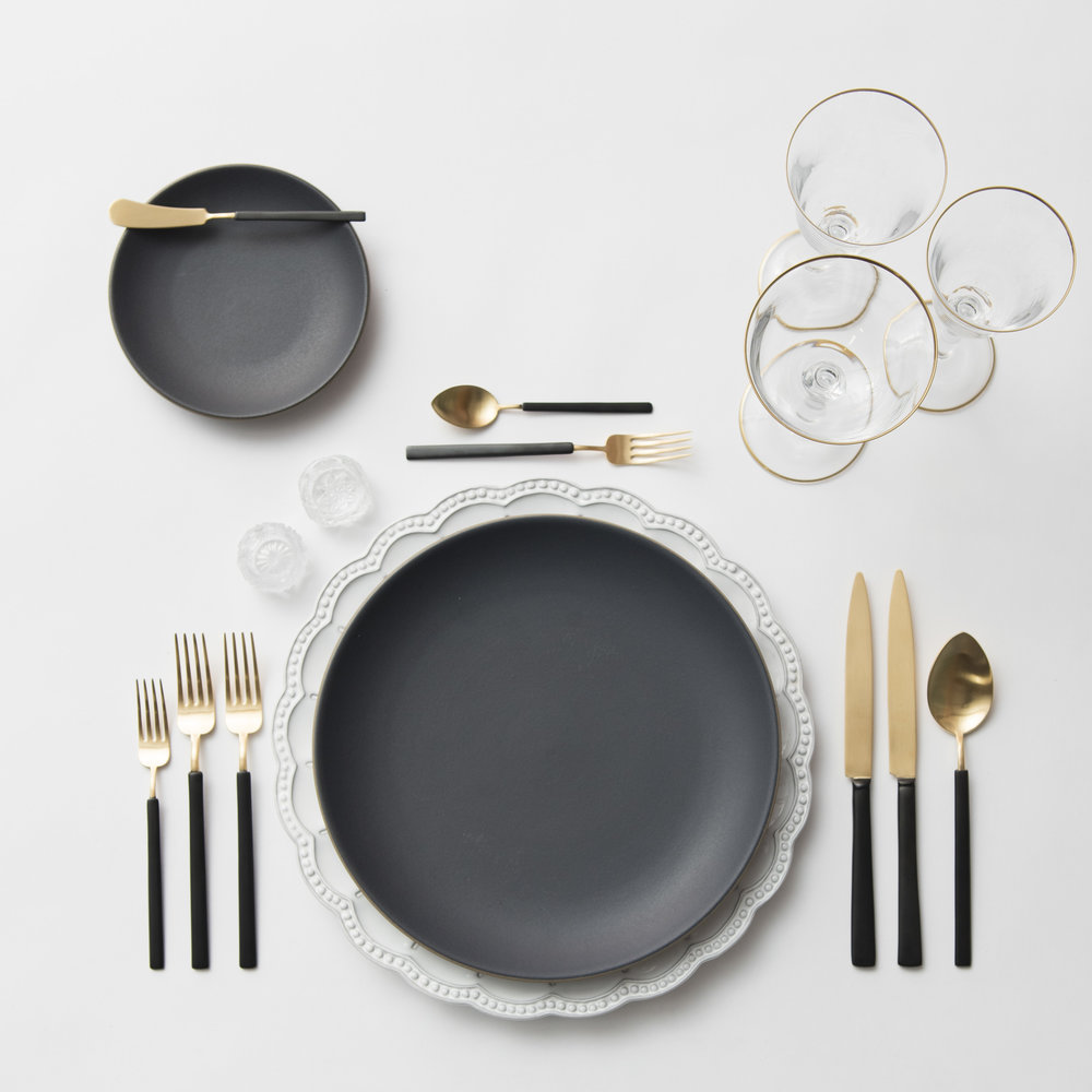 RENT: Signature Collection Chargers + Heath Ceramics in Indigo/Slate + Axel Flatware in Matte 24k Gold/Black + Chloe 24k Gold Rimmed Stemware + Antique Crystal Salt Cellars  SHOP: Chloe 24k Gold Rimmed Stemware