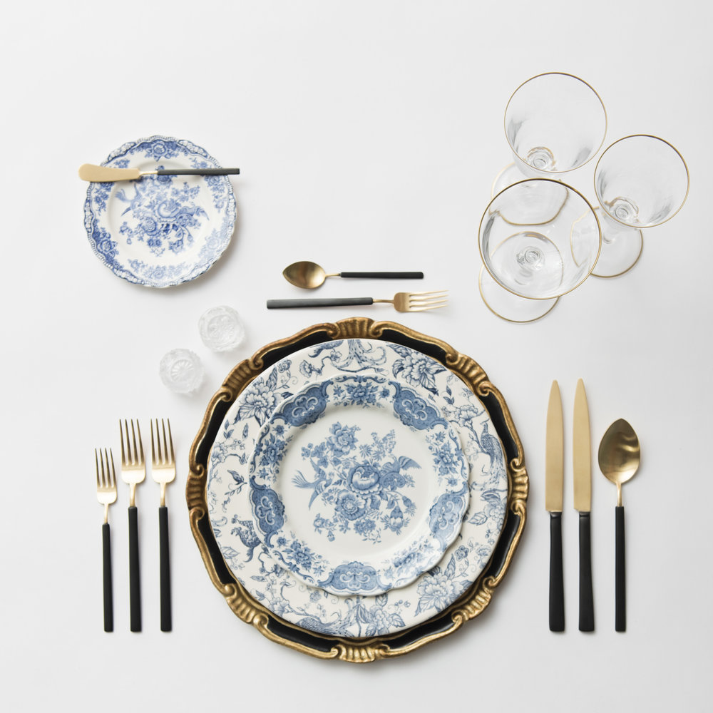 RENT: Florentine Chargers in Black/Gold + Blue Garden Collection Vintage China + Axel Flatware in Matte 24k Gold/Black + Chloe 24k Gold Rimmed Stemware + Antique Crystal Salt Cellars  SHOP: Chloe 24k Gold Rimmed Stemware