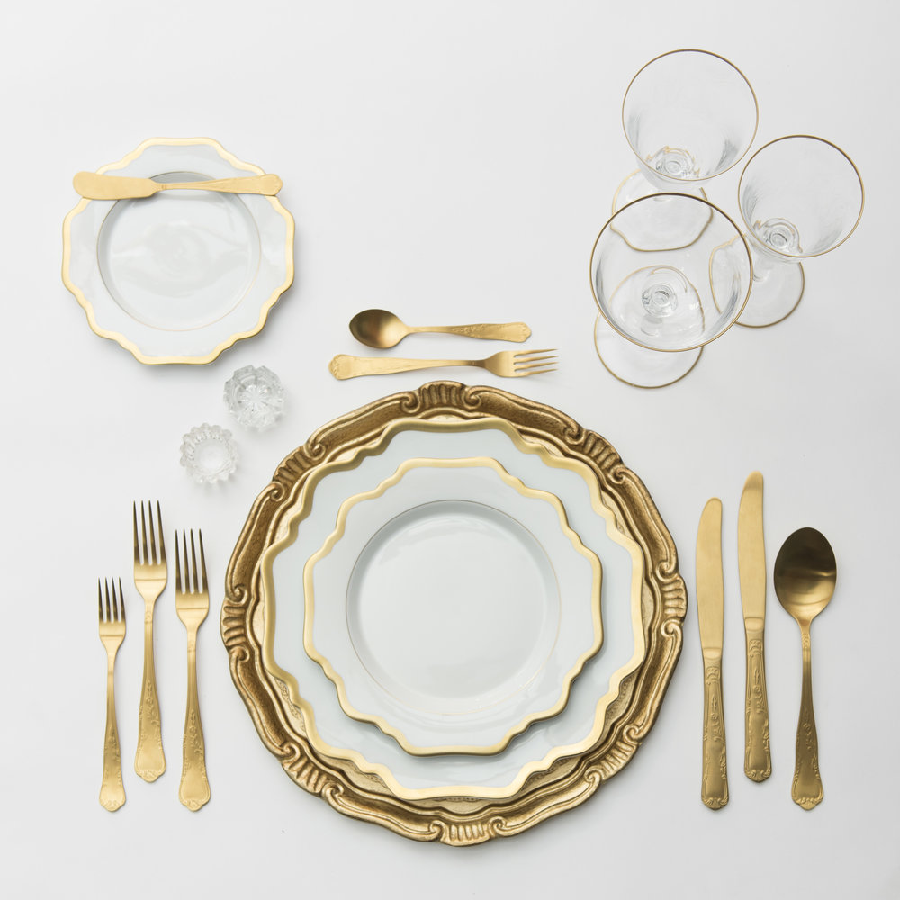 RENT: Florentine Chargers in Gold + Anna Weatherley Dinnerware in White/Gold + Chateau Flatware in Matte Gold + Chloe 24k Gold Rimmed Stemware + Antique Crystal Salt Cellars   SHOP: Florentine Chargers in Gold + Anna Weatherley Dinnerware in White/Gold + Chloe 24k Gold Rimmed Stemware