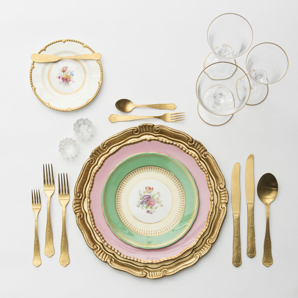 RENT: Florentine Charger in Gold + Pink/Green/White Botanicals Vintage China + Chateau Flatware in Matte Gold + Chloe 24k Gold Rimmed Stemware + Antique Crystal Salt Cellars  SHOP: Florentine Charger in Gold + Chloe 24k Gold Rimmed Stemware