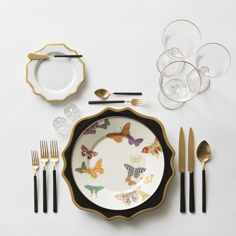 RENT: Anna Weatherley Chargers in Black/Gold + Anna Weatherley Dinnerware in White/Gold + MacKenzie-Childs Butterfly Garden Collection + Axel Flatware in Matte 24k Gold/Black + Chloe 24k Gold Rimmed Stemware + Antique Crystal Salt Cellars  SHOP: Anna Weatherley Dinnerware in White/Gold + Chloe 24k Gold Rimmed Stemware