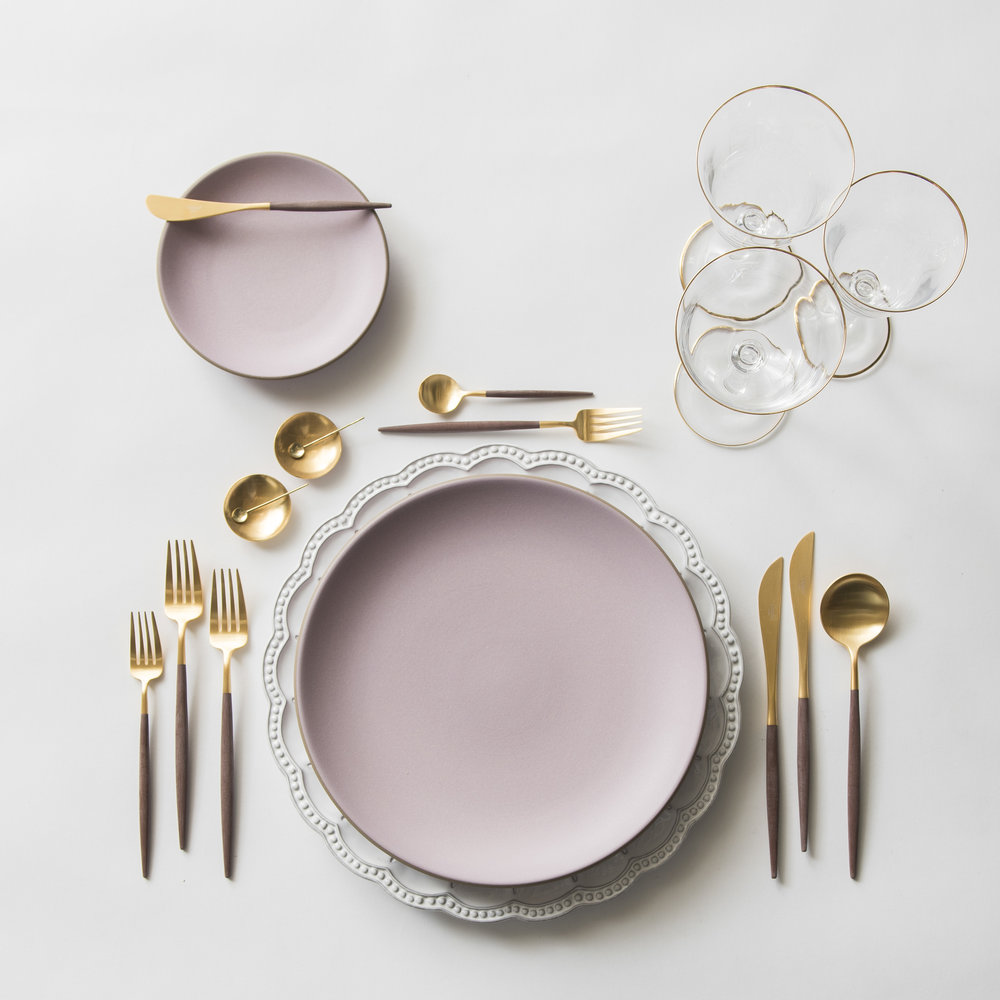 RENT: Signature Collection  Chargers + Custom Heath Ceramics in Lilac + Goa Flatware in Brushed 24k Gold/Wood + Chloe 24k Gold Rimmed Stemware + 14k Gold Salt Cellars + Tiny Gold Spoons   SHOP:  Goa Flatware in Brushed 24k   Gold/Wood + Chloe 24k Gold Rimmed Stemware + 14k Gold Salt Cellars + Tiny Gold   Spoons