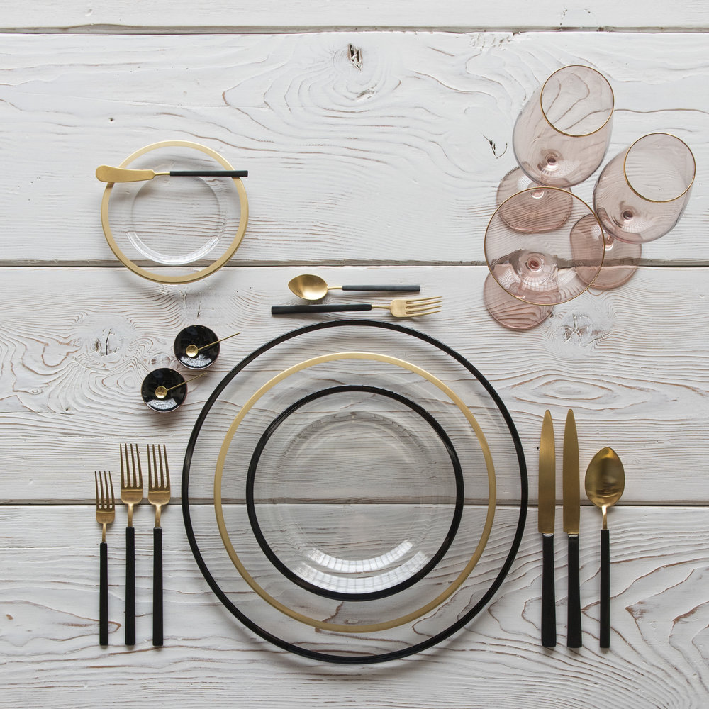 RENT: Halo Glass Chargers/Dinnerware in Black + Halo Glass Dinnerware in 24k Gold + Axel Flatware in Matte 24k Gold/Black + Bella 24k Gold Rimmed Stemware in Blush + Black Enamel Salt Cellars + Tiny Gold Spoons  SHOP: Halo Glass Chargers/Dinnerware in Black + Halo Glass Dinnerware in 24k Gold + Bella 24k Gold Rimmed Stemware in Blush + Black Enamel Salt Cellars + Tiny Gold Spoons