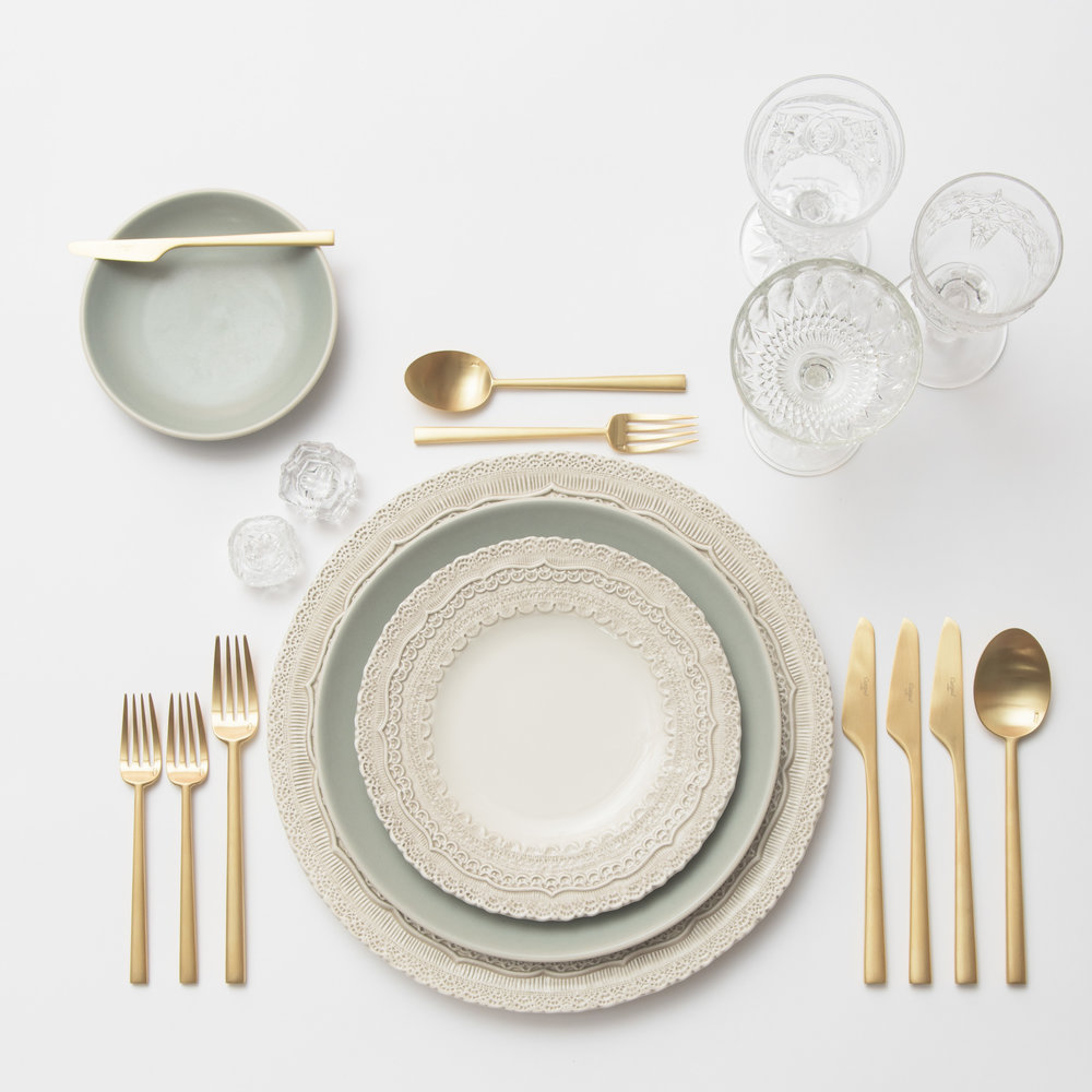 RENT: Lace Chargers/Dinnerware in White + Heath Ceramics in Mist + Rondo Flatware in Brushed 24k Gold + Early American Pressed Glass Goblets + Antique Crystal Salt Cellars  SHOP: Rondo Flatware in Brushed 24k Gold