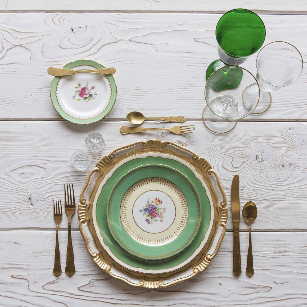RENT: Florentine Chargers in White/Gold + Green Botanicals Vintage China + Chateau Flatware in Matte Gold + Chloe 24k Gold Rimmed Stemware + Chloe 24k Gold Rimmed Goblet in Emerald + Antique Crystal Salt Cellars   SHOP: Florentine Chargers in White/Gold + Chloe 24k Gold Rimmed Stemware