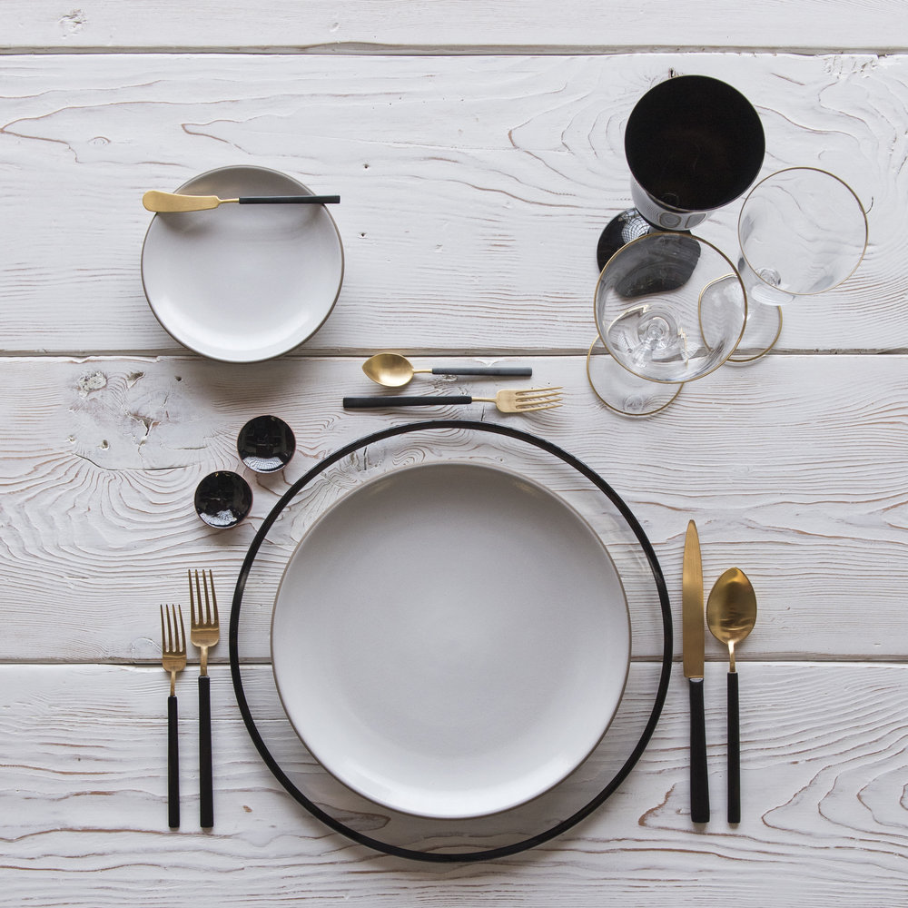 RENT: Halo Glass Chargers in Black + Heath Ceramics in Opaque White + Axel Flatware in Matte 24k Gold/Black + Chloe 24k Gold Rimmed Stemware + Chloe 24k Gold Rimmed Goblet in Black + Black Enamel Salt Cellars  SHOP: Halo Glass Chargers in Black + Chloe 24k Gold Rimmed Stemware + Black Enamel Salt Cellars