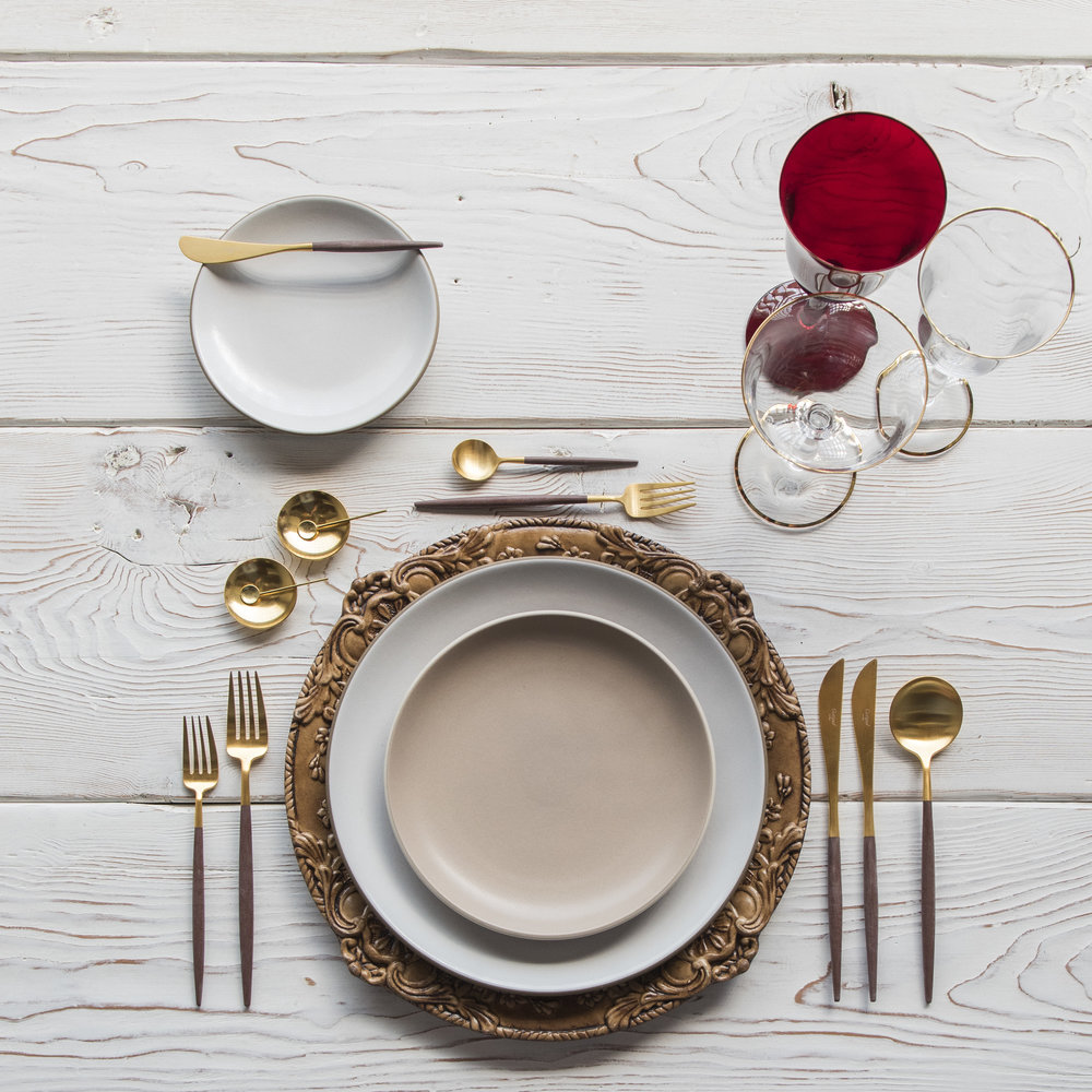 RENT: Verona Chargers in Walnut + Heath Ceramics in Opaque White/French Grey + Goa Flatware in Brushed 24k Gold/Wood + Chloe 24k Gold Rimmed Stemware + Chloe 24k Gold Rimmed Goblet in Ruby + 14k Gold Salt Cellars + Tiny Gold Spoons  SHOP: Verona Chargers in Walnut + Goa Flatware in Brushed 24k Gold/Wood + Chloe 24k Gold Rimmed Stemware + 14k Gold Salt Cellars + Tiny Gold Spoons