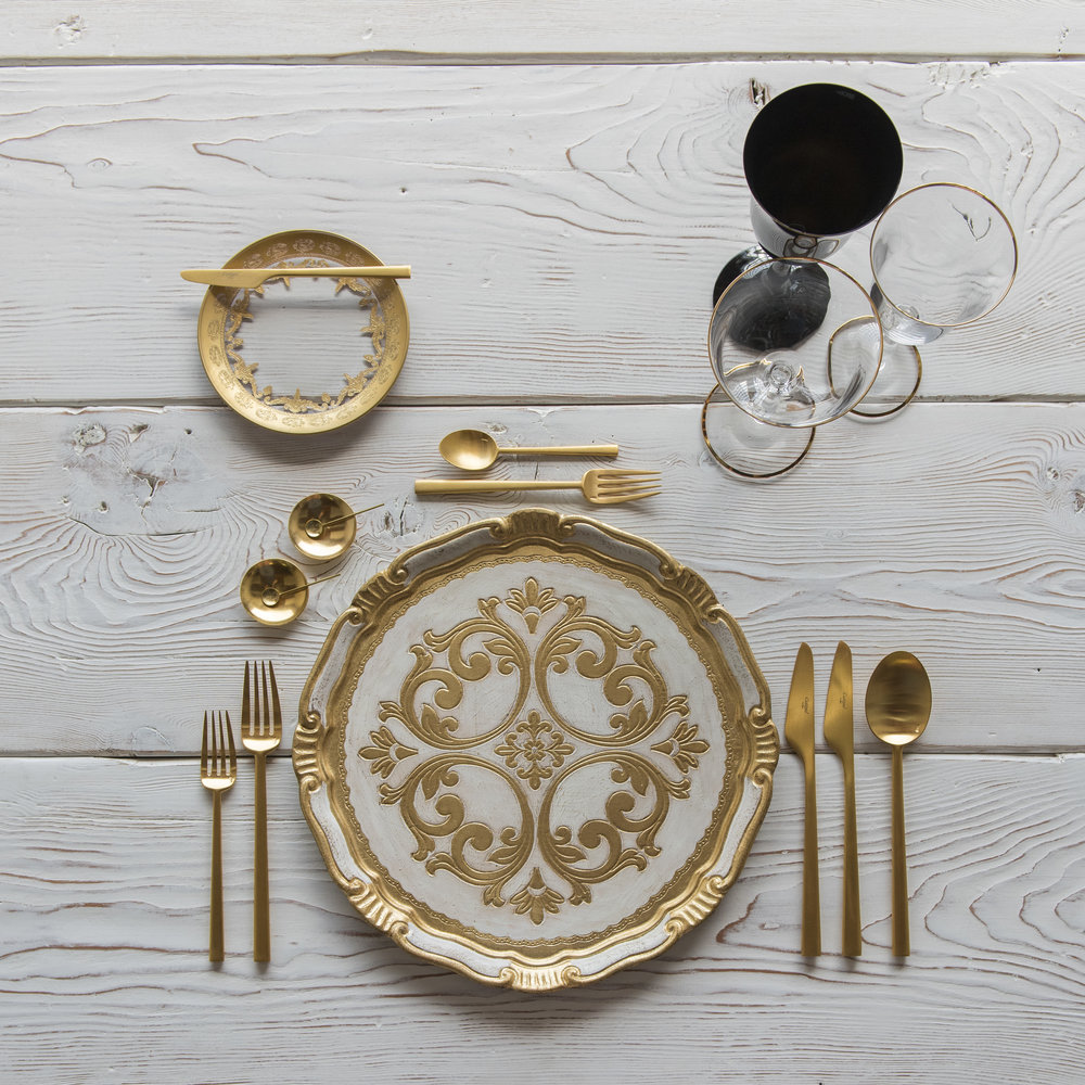 RENT: Florentine Chargers in White/Gold + Versailles Glass Dinnerware in 24k Gold + Rondo Flatware in Brushed 24k Gold + Chloe 24k Gold Rimmed Stemware + Chloe 24k Gold Rimmed Goblet in Black + 14k Gold Salt Cellars + Tiny Gold Spoons   SHOP: Florentine Chargers in White/Gold + Rondo Flatware in Brushed 24k Gold + Chloe 24k Gold Rimmed Stemware + 14k Gold Salt Cellars + Tiny Gold Spoons