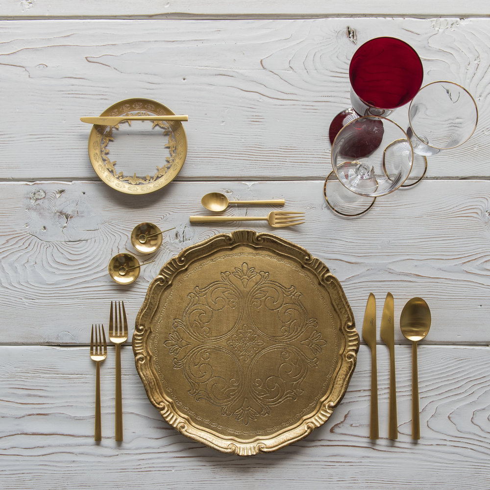 RENT: Florentine Chargers in Gold + Versailles Glass Dinnerware in 24k Gold + Rondo Flatware in Brushed 24k Gold + Chloe 24k Gold Rimmed Stemware + Chloe 24k Gold Rimmed Goblet in Ruby + 14k Gold Salt Cellars + Tiny Gold Spoons  SHOP: Florentine Chargers in Gold + Rondo Flatware in Brushed 24k Gold + Chloe 24k Gold Rimmed Stemware + 14k Gold Salt Cellars + Tiny Gold Spoons