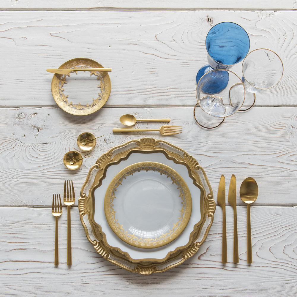 RENT: Florentine Chargers in White/Gold + Anna Weatherley Dinnerware in White/Gold + Versailles Glass Dinnerware in 24k Gold + Rondo Flatware in Brushed 24k Gold + Chloe 24k Gold Rimmed Stemware + Chloe 24k Gold Rimmed Goblet in Sapphire + 14k Gold Salt Cellars + Tiny Gold Spoons   SHOP: Florentine Chargers in White/Gold + Anna Weatherley Dinnerware in White/Gold + Rondo Flatware in Brushed 24k Gold + Chloe 24k Gold Rimmed Stemware + 14k Gold Salt Cellars + Tiny Gold Spoons