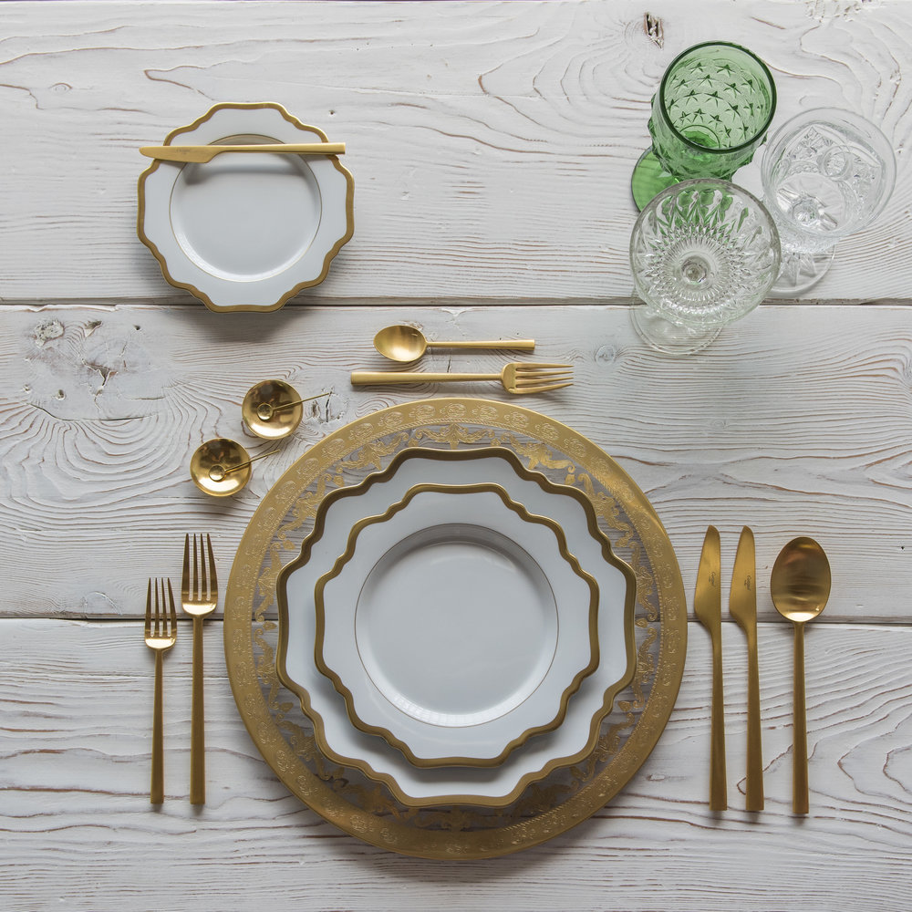 RENT: Versailles Glass Chargers in 24k Gold + Anna Weatherley Dinnerware in White/Gold + Rondo Flatware in Brushed 24k Gold + Green Vintage Goblets + Early American Pressed Glass Goblets + Vintage Champagne Coupes + 14k Gold Salt Cellars + Tiny Gold Spoons   SHOP: Anna Weatherley Dinnerware in White/Gold + Rondo Flatware in Brushed 24k Gold + 14k Gold Salt Cellars + Tiny Gold Spoons