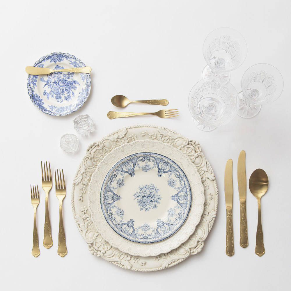 RENT: Verona Chargers in Antique White + White Collection Vintage China + Blue Garden Collection Vintage China + Chateau Flatware in Matte Gold + Czech Crystal Stemware + Antique Crystal Salt Cellars  SHOP: Verona Chargers in Antique White