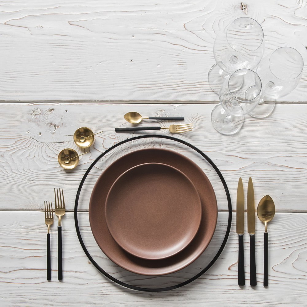 RENT: Halo Glass Chargers in Black + Heath Ceramics in Redwood + Axel Flatware in Matte 24k Gold/Black + Grand Cru Stemware + 14k Gold Salt Cellars + Tiny Gold Spoons   SHOP: Halo Glass Chargers in Black + 14k Gold Salt Cellars + Tiny Gold Spoons