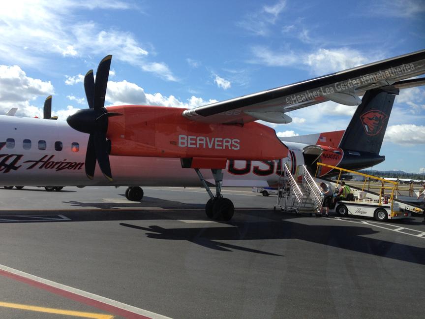 Alaska Air prop plane with Beavers signage
