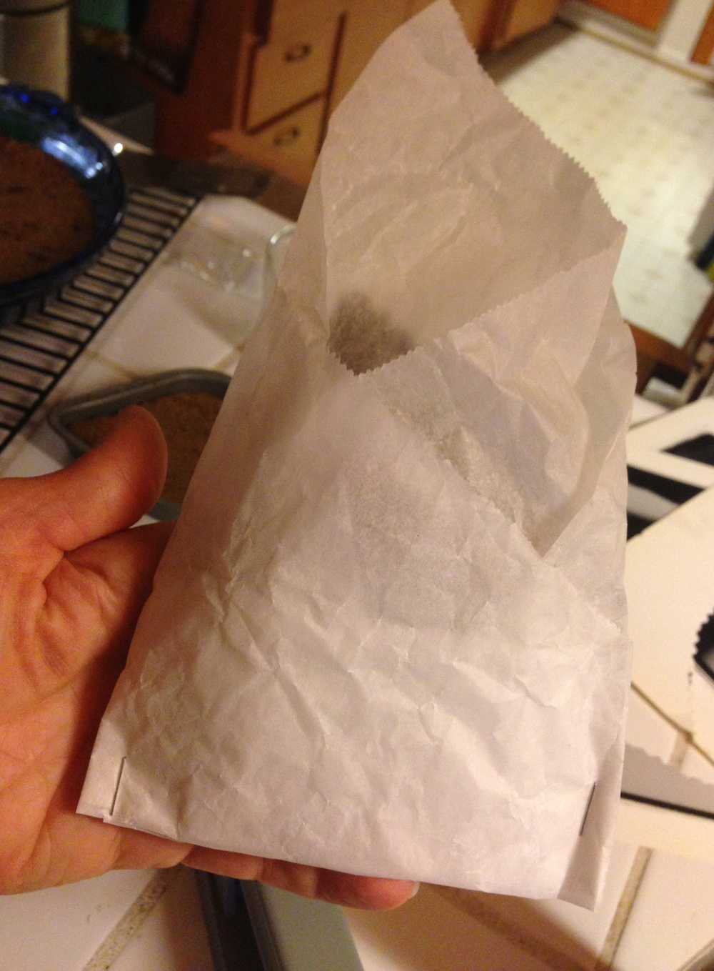 Fold treat inside parchment paper.