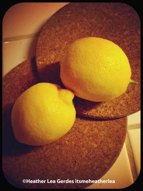 2 lemons on 2 round corkboards