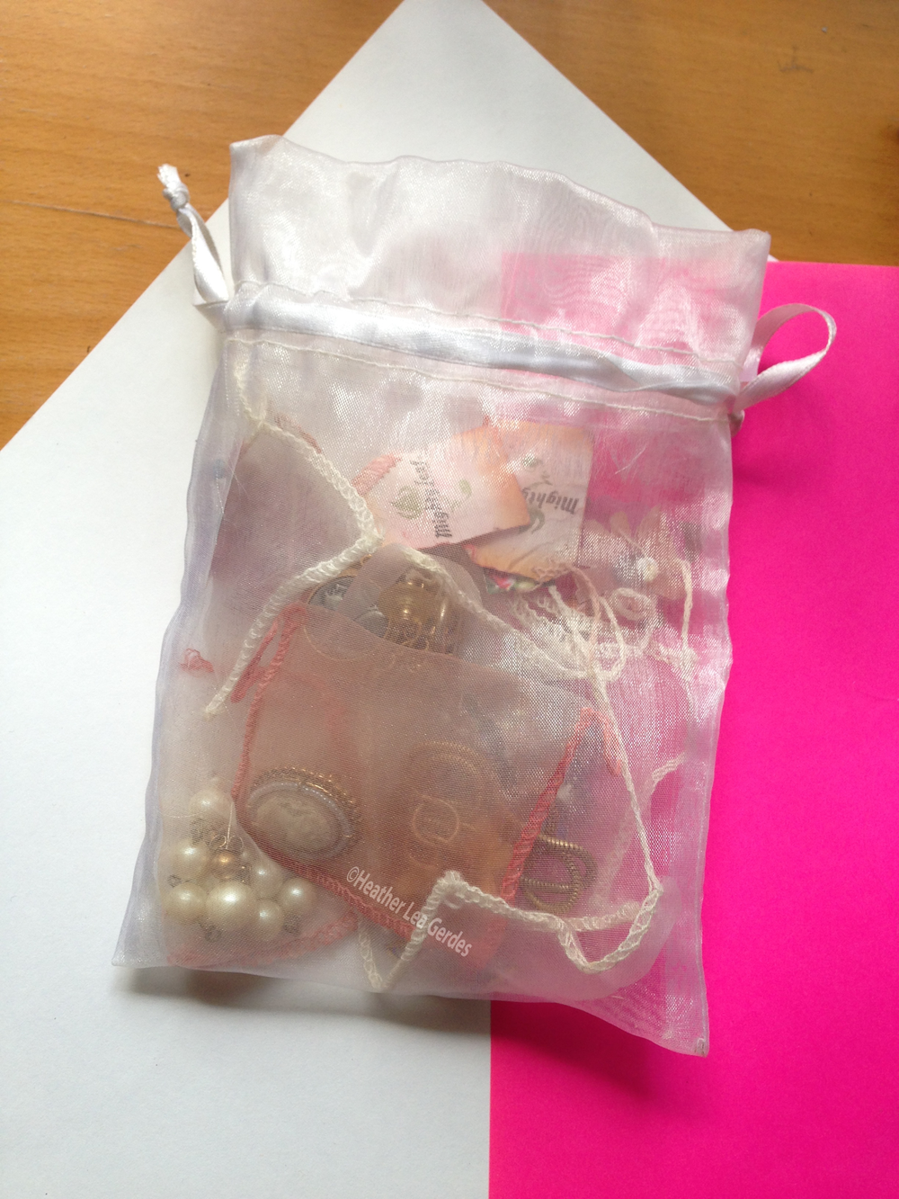 Travel is made easy with several silk tea bag jewelry pouches in a larger pouch.