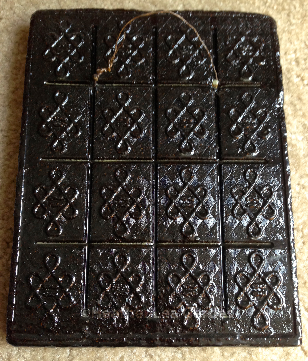 The back of my tea brick. The scored sections could be broken for trading.