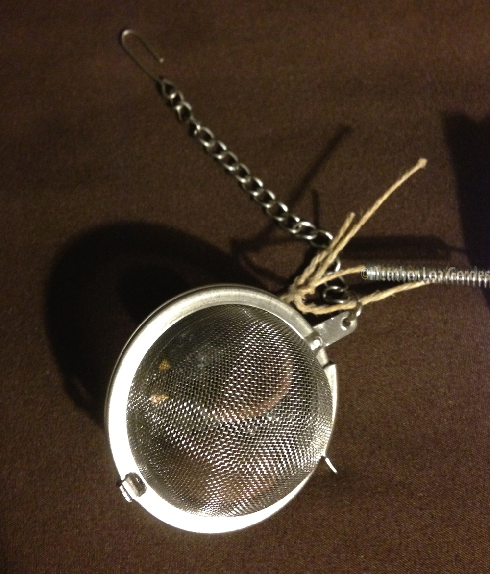 Here's a spiritual Crafty Thing! Fill a tea infuser with an Apache Tear to hang by your bed at night.
