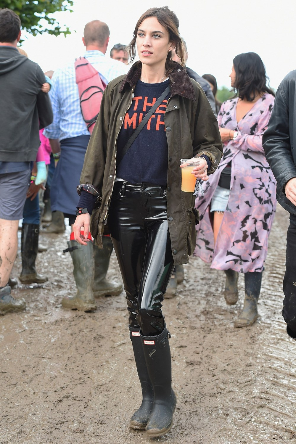 Alexa Chung wearing the token Smiths sweater with some insane Vinyl pants and of course a Glastonbury necessity: Hunter Boots