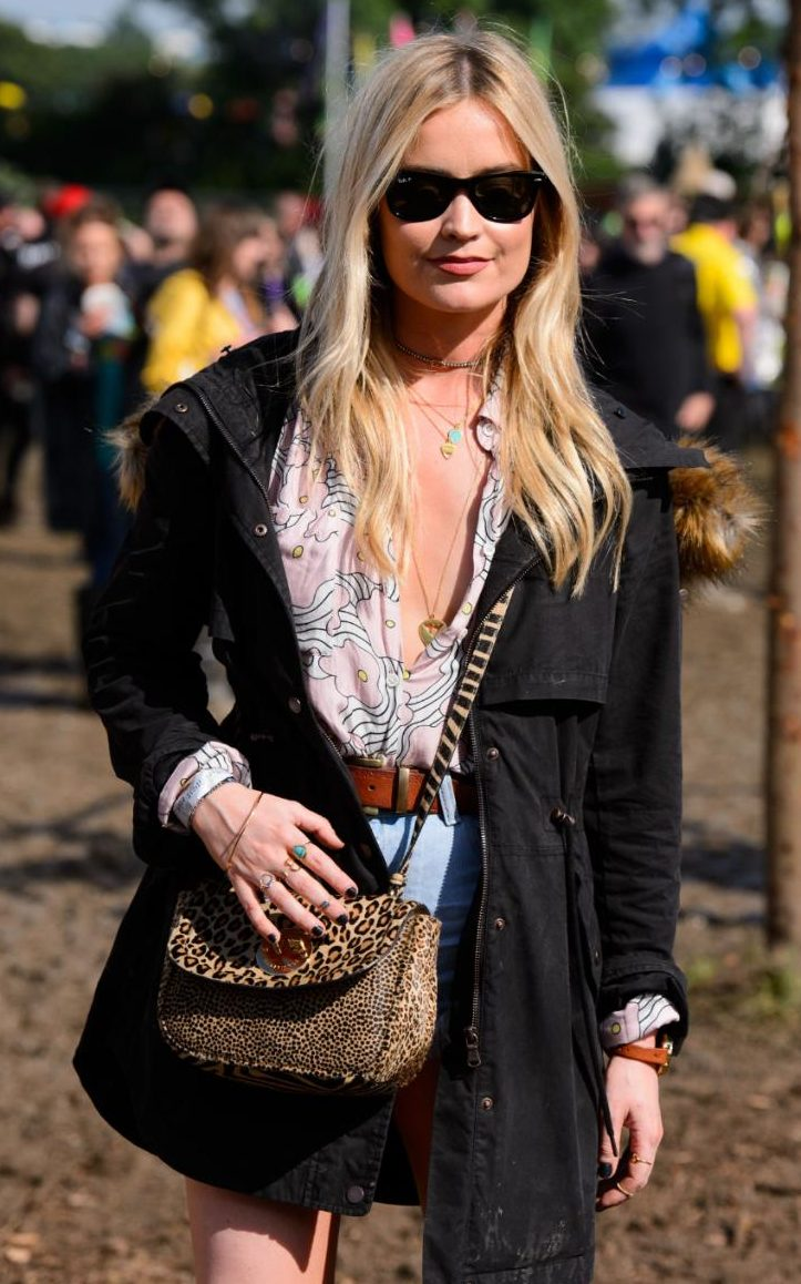 Laura Whitmore  wearing some denim cutoffs paired with a 70's blouse and an amazing printed cross-body