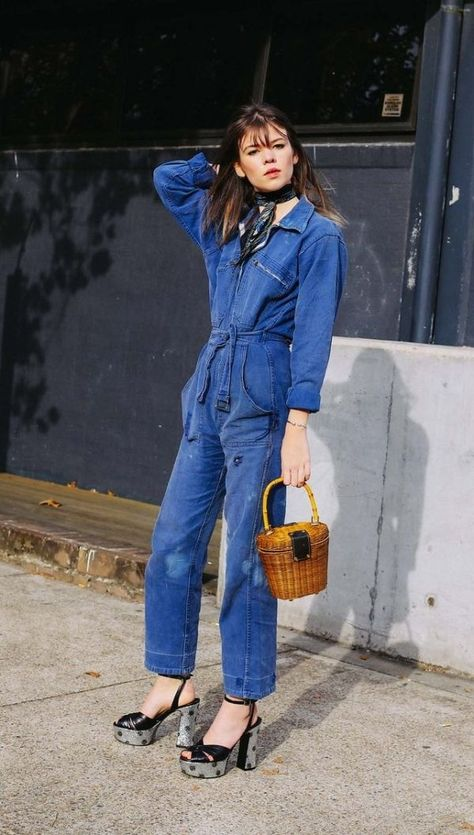 Heres a perfect example of the *tailored* holiday look in my book. If you're not completely able to thrown on a bathing suit, grab your woven bag, and lay on a yacht somewhere in St.Barths, try out this look instead French inspired look instead. Denim jumpsuit, scarf, platforms, AND YOUR WOVEN BAG.