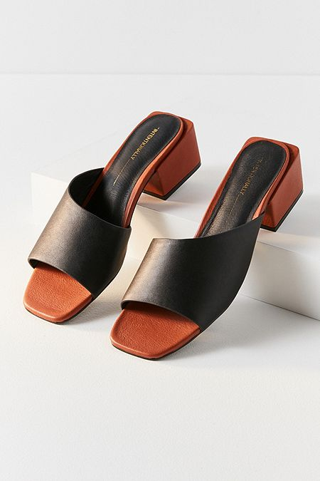 Intentionally Blank Roll Asymmetrical Mule Heel