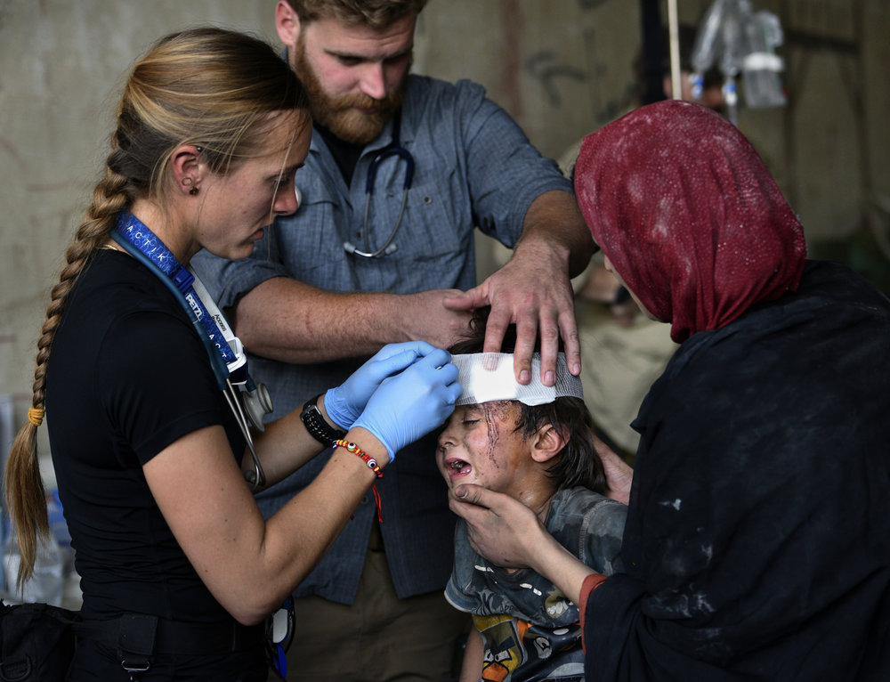 Global Response Management Team Member providing live saving medical care in Iraq