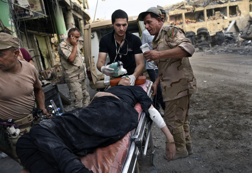 Global Response Management Team Members providing emergency trauma care in Iraq