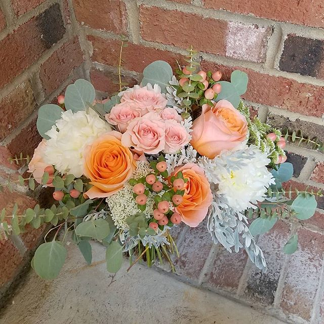 Rachel's bridal bouquet.. #bridalbouquet #bridalparty #peachbouquet #peachwedding #berries #peonies #eucalyptus #summerwedding #summerbouquet #dustymiller #coral #sprayrose #organic #peachandcoral #raleighflowers #raleighflorist #oakcity