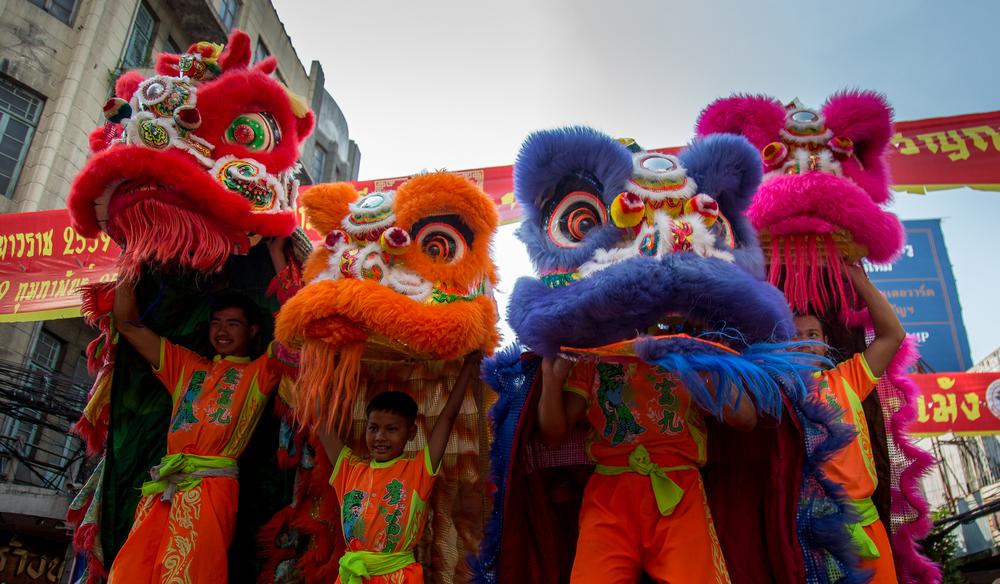 Four dragons make their way down Yawarat, the main street in Bangkok's Chinatown.