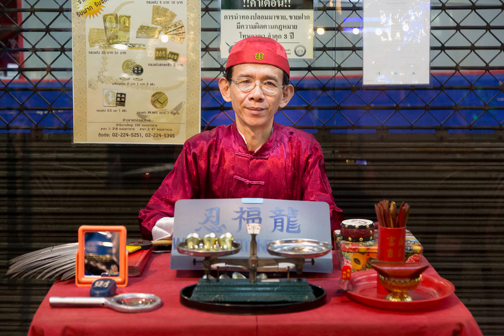 "I passed by this fortune teller on the main street in Bangkok's Chinatown and asked to take his photograph. After I took it, he stood up and walked over to me. ""Where are you from?"" he asked. When I told him, he responded with, ""The US and Thailand have always been good friends. Thank you."""