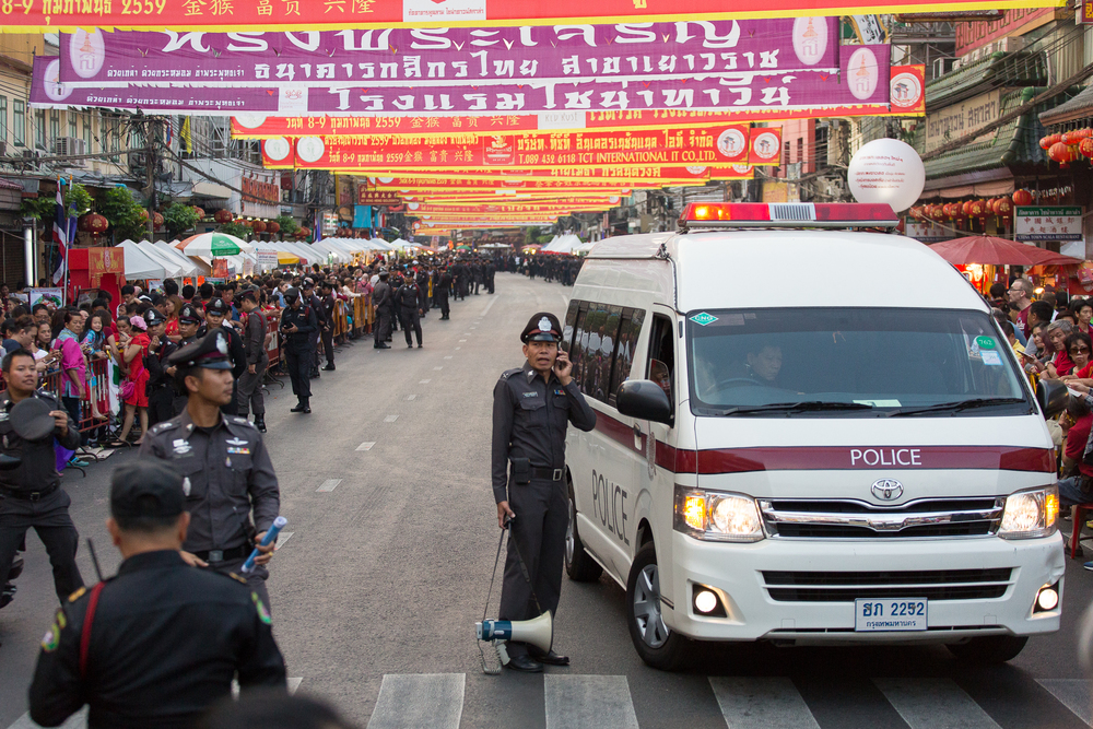 The street is cleared in advance to make way for Thailand's princess. The royal family is greatly respected by the Thai people. Unless authorized, photographs of the princess are forbidden.