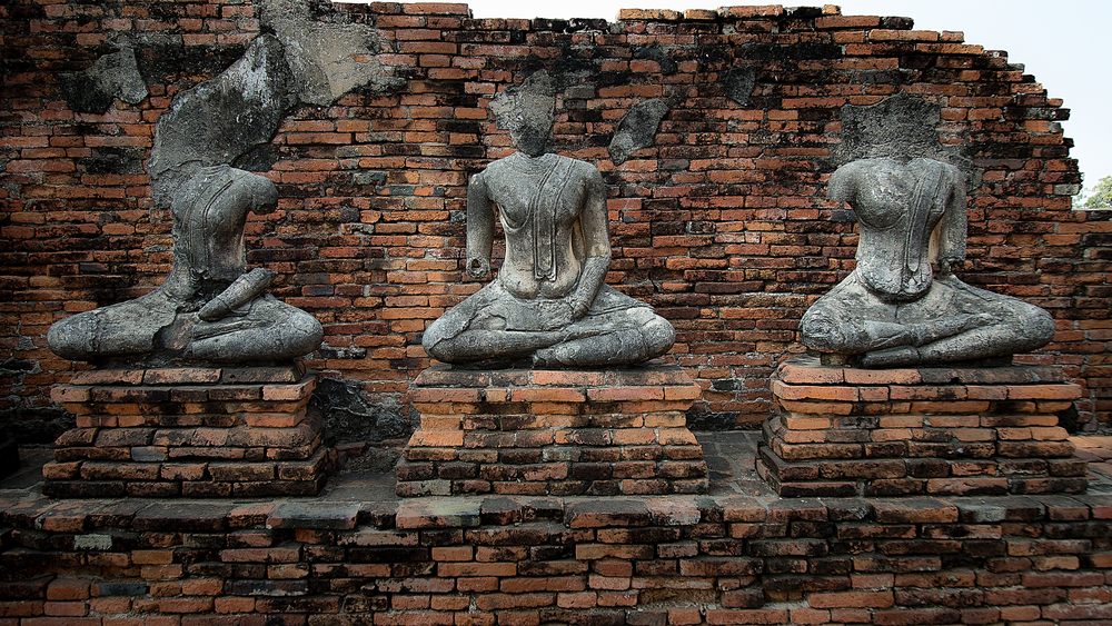 Statues of Buddha that have been whithered away over time.