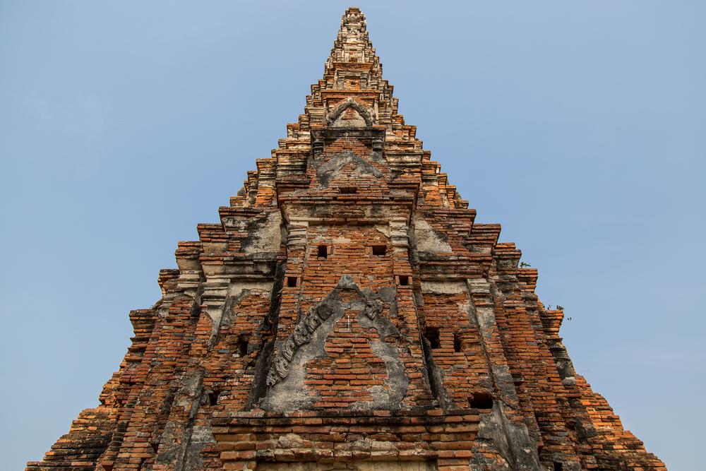 A spire at Chai Watthanaram Temple stretches into the air.