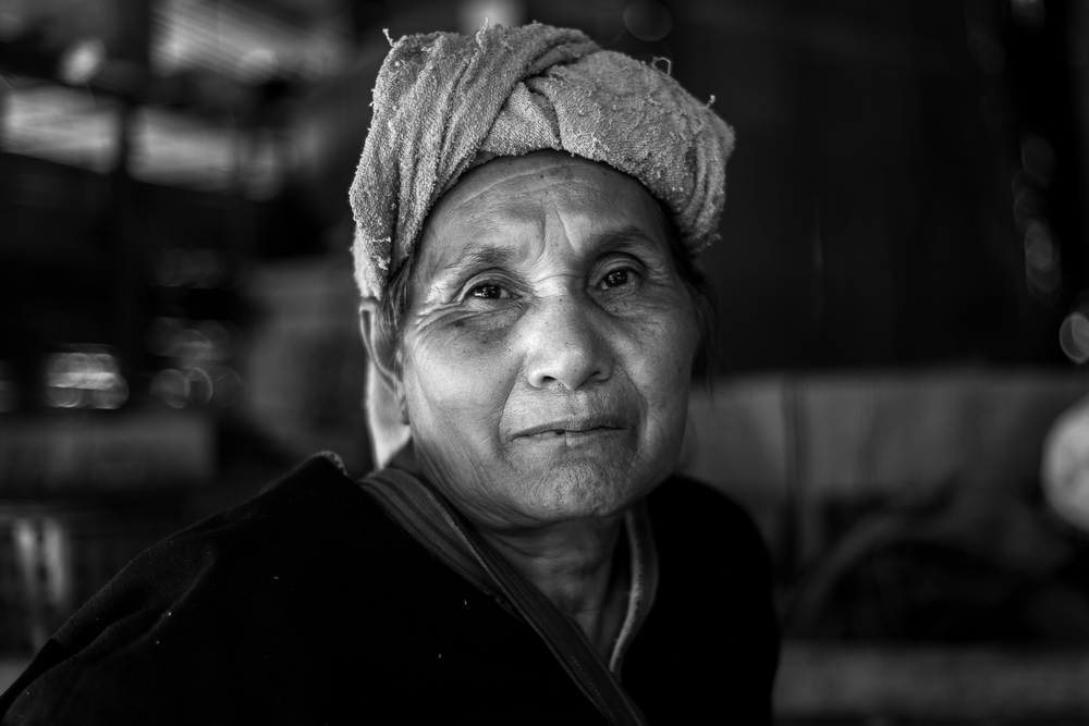 "After asking permissions to take her photograph and showing her this image, the woman said something to the extent of, ""I'm not as beautiful as I once was,"" in Thai. I responded in Thai with, ""No, you are very beautiful."""