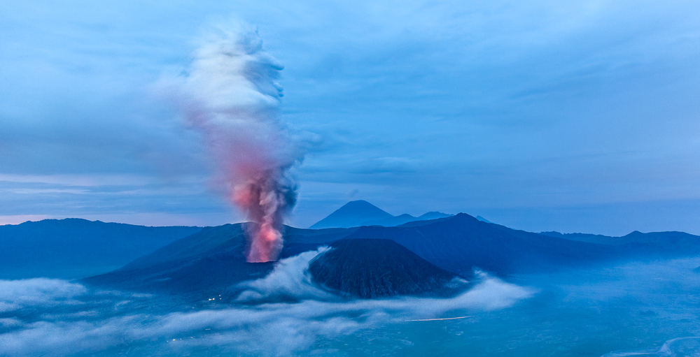 In the early hours of the morning before the sun rises, it's possible to see the orange glow of the lava illuminate the plume errupting from the volcano.