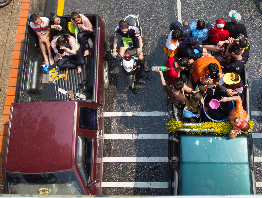 Many people rode around the perimeter of the old city in the backs of pickup trucks.